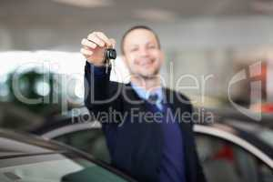 Man standing while holding car keys