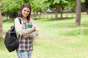 Young student holding textbook