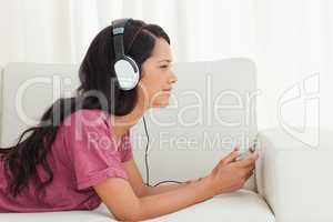 Cute Latino listening to music with her smartphone