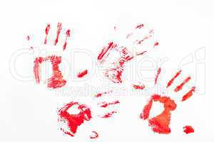Four red handprints