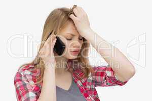 Upset woman holding a mobile phone