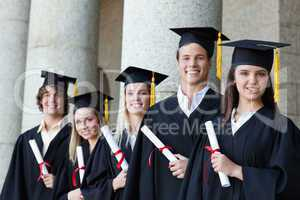 Portrait of graduates posing in single line