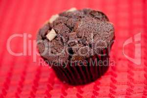 Chocolate muffin on a tablecloth