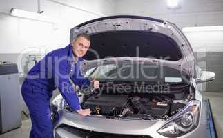 Mechanic with his thumb up