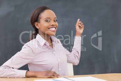 Black teacher showing the blackboard