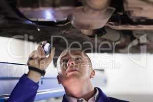 Mechanic holding a flashlight