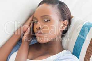 Black woman looking at camera while lying