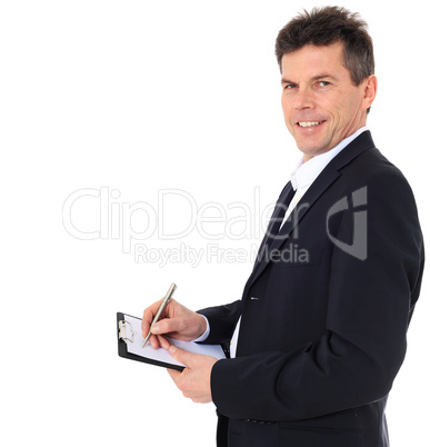 Geschäftsmann notiert etwas