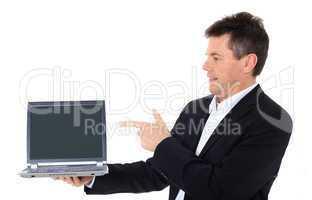 Geschäftsmann zeigt auf den Bildschirm eines Computers