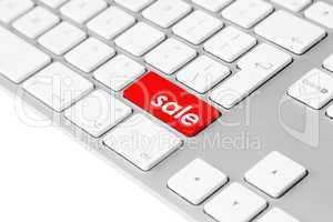Computer keyboard with red sale button