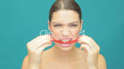 Playful woman with red jelly smile