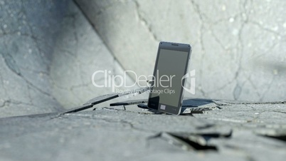 Smart phone falling down and smashing the concrete floor with slow motion. Alpha is included