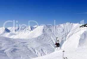 Skiers on ropeway at ski resort Gudauri