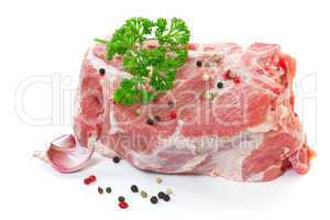 Raw meat with spices on a white background
