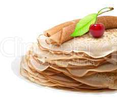 Pancakes with cherries on a white background