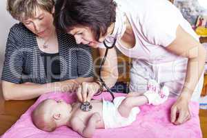 Doctor examines baby