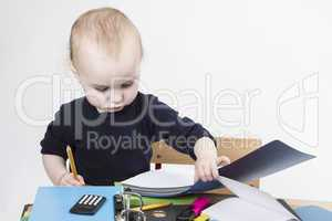 young child at writing desk