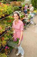 Woman at garden center shopping for flowers