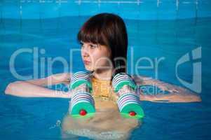 Pretty girl doing aqua aerobic exercise