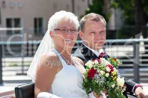 Bride and groom at the horse-drawn carriage ride