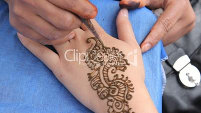 Woman Getting A Henna Tattoo On Her Hand