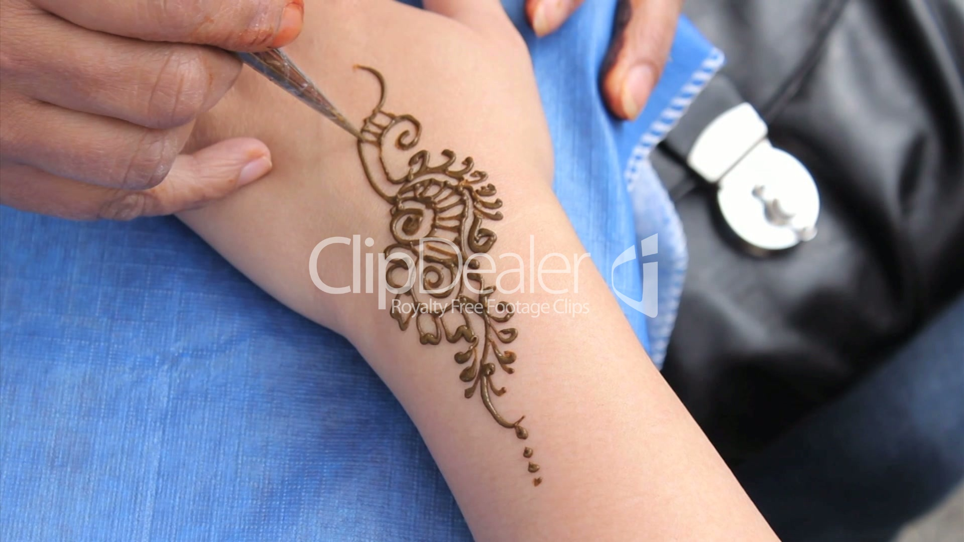 Mehndi Tattoo Hip : Woman getting a henna tattoo on her wrist royalty free video and