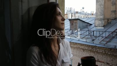 Beautiful woman at a window slider