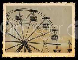 vintage photo of ferris wheel in amusement park