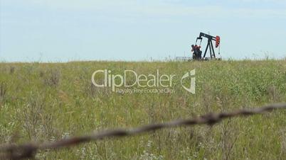 Oil Pump Behind Barbed Wire