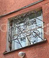 metal forged carved lattice at a plastic white window