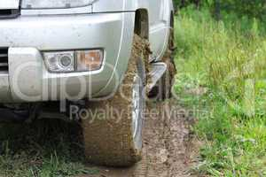 Extreme offroad behind an unrecognizable car in mud