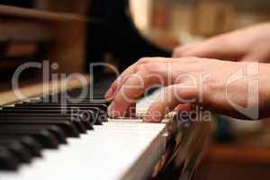 hands of a piano playing guy in a sensitive mood