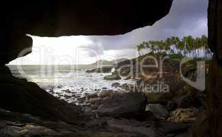 Cave at rocky coastline in Goa