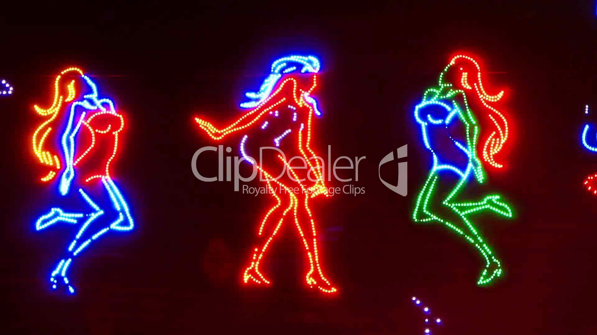 dancing girls neon sign royalty free video and stock footage. Black Bedroom Furniture Sets. Home Design Ideas
