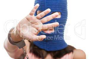 Woman in balaclava hiding face