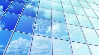 clouds reflected in windows of skyscraper loop