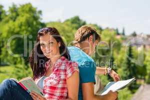 Young woman hold map visit tourist destination