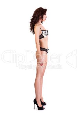 Beautiful underwear model posing on a white