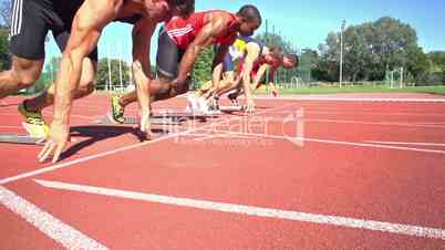 slow motion of four sprinters on start