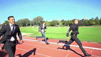 slow motion business men finishing run