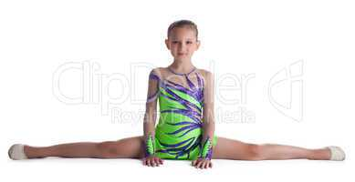 Kid gymnast doing split in green costume