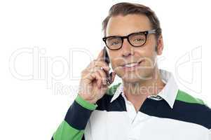 Young man communicating via cellphone