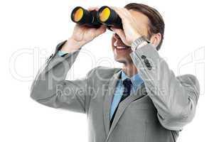 Businessman viewing through binoculars