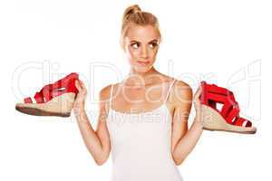 Woman holding red sandals