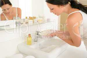 Woman bathroom hand-wash with soap above sink