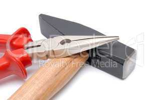 Hammer and flat-nose pliers with red handles isolated over white background