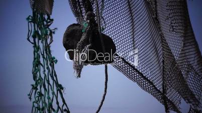 Old fishing nets blowing in the wind. Old and rusted machinery. HD 1080p. Beach in Reykjavik Iceland.