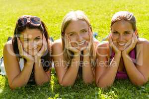 Teen women relaxing in park smiling friends