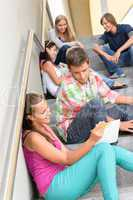 Students talking relaxing on school steps teens