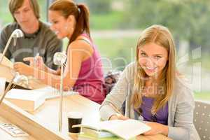 Student taking notes in study room